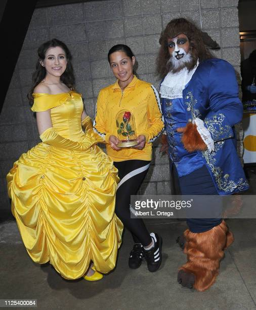Actress LLove'a Brittingham poses with cosplayers dressed like 'Beauty The Beast' at the 2019 Long Beach Comic Expo held at Long Beach Convention...