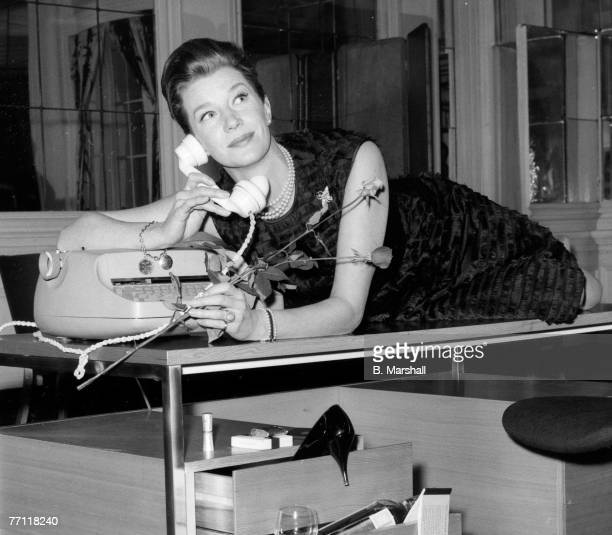 Actress Lois Maxwell drapes herself across a desk designed by Intra Design Ltd a company set up by the Rank Organisation on February 12, 1964. On...