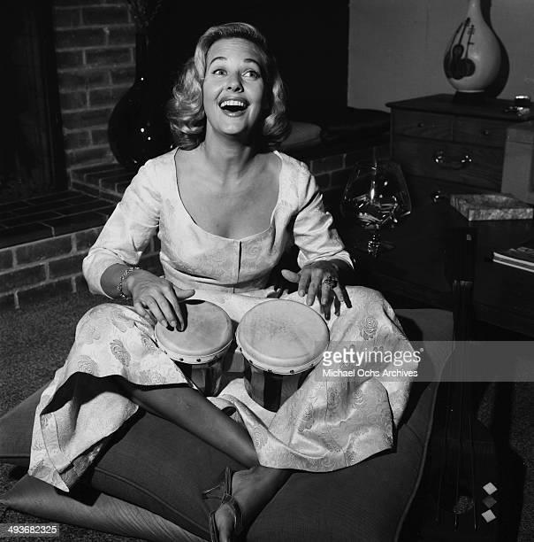 Actress Lola Albright plays the bongos in Los Angeles California