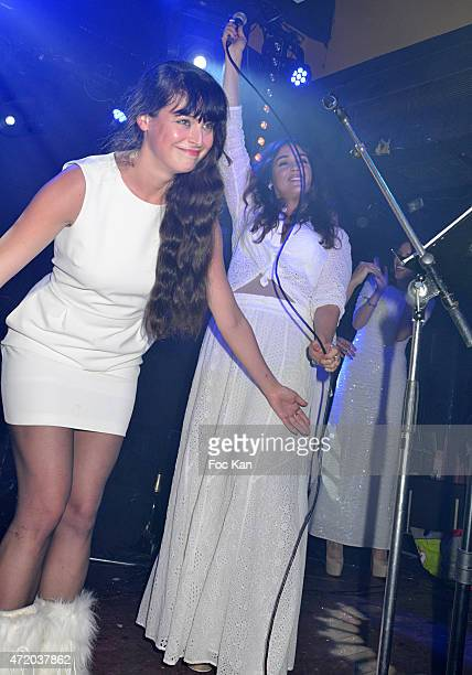 Actress Lola Dewaere and a singer perform during the Nicolas Ullmann White Birthday Party at Le Bus Palladium on May 2 2015 in Paris France