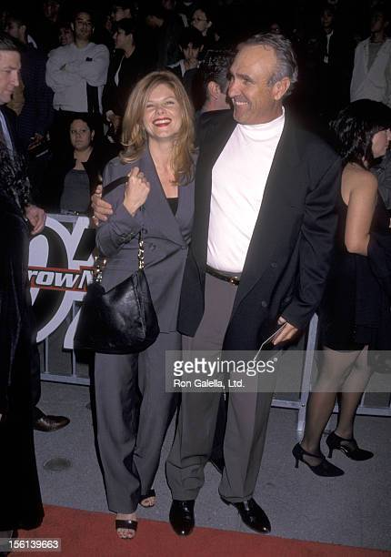 Actress Lolita Davidovich and Writer Ron Shelton attend the 'Tomorrow Never Dies' Los Angeles Premiere on December 16 1997 at Dorothy Chandler...