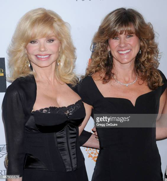 Actress Loni Anderson and daughter Deidra Hoffman arrive at the 21st Annual Race To Erase MS Gala at the Hyatt Regency Century Plaza on May 2 2014 in...