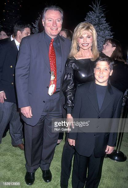 Actress Loni Anderson boyfriend Geoff Brown and her son Quinton Reynolds attend The Grinch Universal City Premiere on November 8 2000 at the...