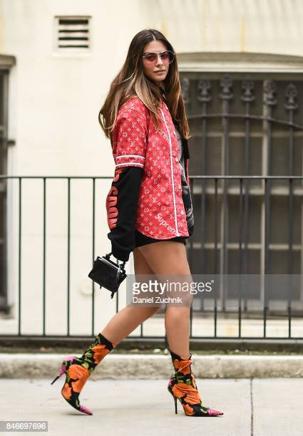 Actress Lorenza Izzo is seen wearing a Louis Vuitton x Supreme jacket Vetements hoodie Balenciaga shoes and Gentle Monster sunglasses during New York...