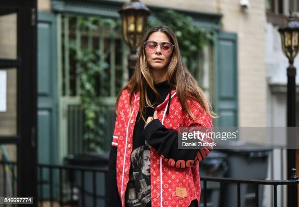 Actress Lorenza Izzo is seen wearing a Louis Vuitton x Supreme jacket Vetements hoodie and Gentle Monster sunglasses during New York Fashion Week...