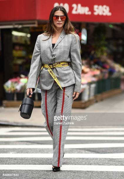 Actress Lorenza Izzo is seen wearing a Thom Browne blazer, Annakiki pants, Off White belt and Gentle Monster sunglasses during New York Fashion Week:...