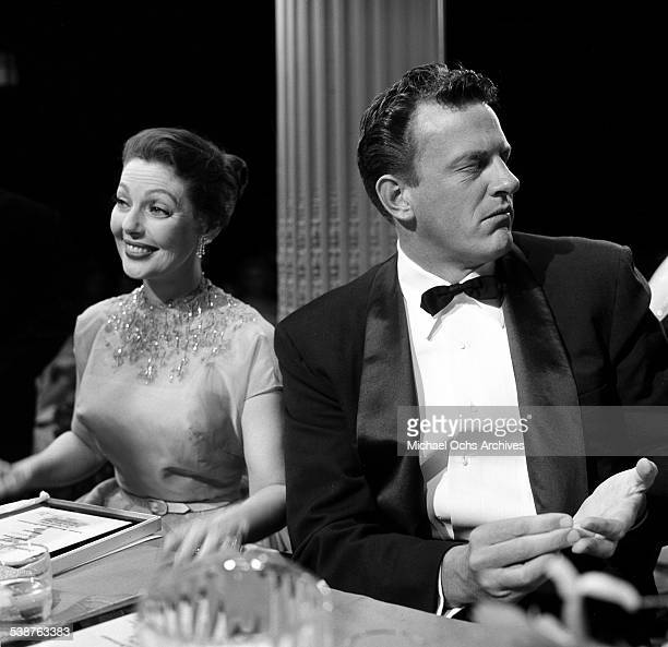 Actress Loretta Young sits next to actor James Arness during the 9th Primetime Emmy Awards in Los Angeles,CA.