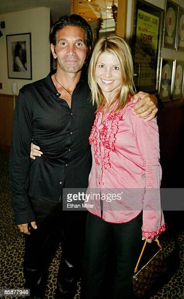 Actress Lori Laughlin and her husband Mossimo Giannulli appear during an Oasis concert at The Joint inside the Hard Rock Hotel Casino April 26 2002...
