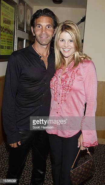 Actress Lori Laughlin and husband/designer Mossimo Giannulli arrive April 26 2002 at the Hard Rock Hotel in Las Vegas NV A 21st birthday party for...