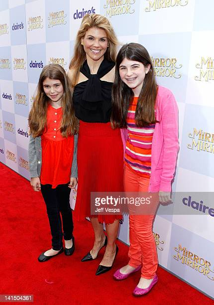 Actress Lori Loughlin and daughters Olivia Jade Giannulli and Isabella Rose Giannulli attends the Mirror Mirror premiere at Grauman's Chinese Theatre...