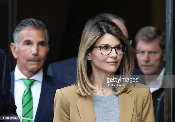 Actress Lori Loughlin and her husband Mossimo Giannulli wearing green tie at left leave the John Joseph Moakley United States Courthouse in Boston on...