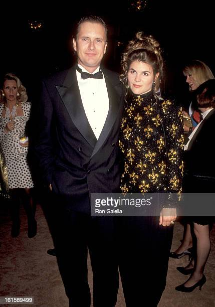 Actress Lori Loughlin and husband Michael Burns attend the Party and Fashion to Celebrate the Grand Opening of the New ESCADA Store in Beverly Hills...