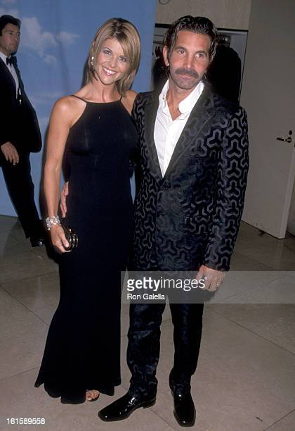 Actress Lori Loughlin and husband Mossimo Giannulli attend the 2000 Carousel of Hope Ball on October 28 2000 at Beverly Hilton Hotel in Beverly Hills...