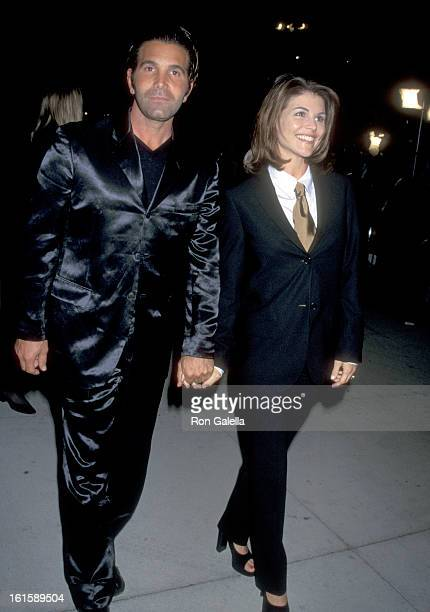 Actress Lori Loughlin and husband Mossimo Giannulli attend the Fourth Annual Vanity Fair Oscar Party on March 24 1997 at Morton's Restaurant in West...