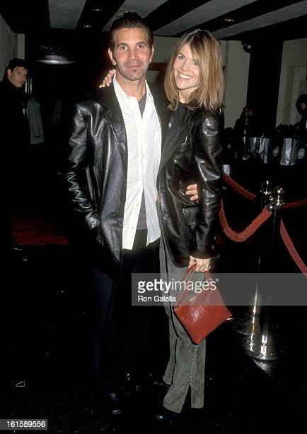 Actress Lori Loughlin and husband Mossimo Giannulli attend the GQ's Leading Men Party on February 16 2000 at The Sunset Club in Hollywood California