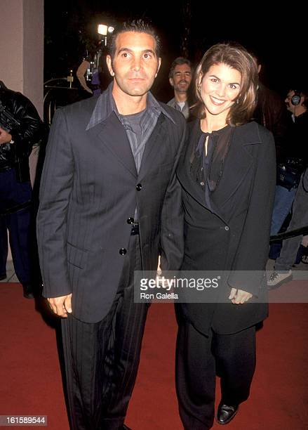 Actress Lori Loughlin and husband Mossimo Giannulli attend the Cocktail Party Hosted by Art Cooper in Honor of Peter Bart on December 12 1995 at...