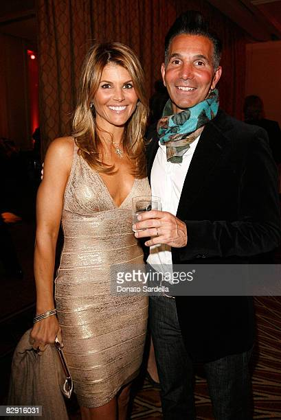 Actress Lori Loughlin and husband Mossimo Giannulli attend the Saks Fifth Avenue's Unforgettable Evening cocktail reception benefiting Entertainment...