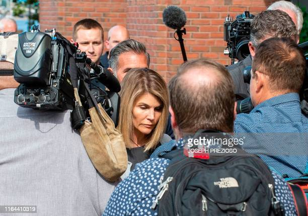 Actress Lori Loughlin and husband Mossimo Giannulli exit the Boston Federal Court house after a pretrial hearing with Magistrate Judge Kelley at the...