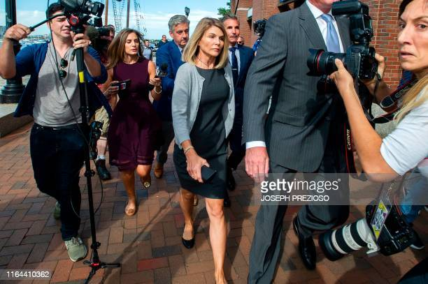 Actress Lori Loughlin and husband Mossimo Giannulli exit the Boston Federal Court house after a pre-trial hearing with Magistrate Judge Kelley at the...