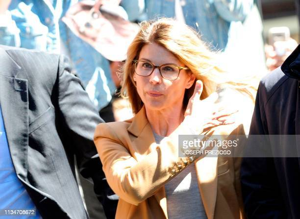 Actress Lori Loughlin arrives at the court to appear before Judge M Page Kelley to face charge for allegedly conspiring to commit mail fraud and...