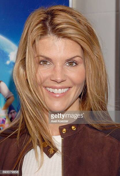 Actress Lori Loughlin arrives at the Los Angeles premiere of the movie 'Happily N'Ever After' at Mann's Festival Theater in Westwood