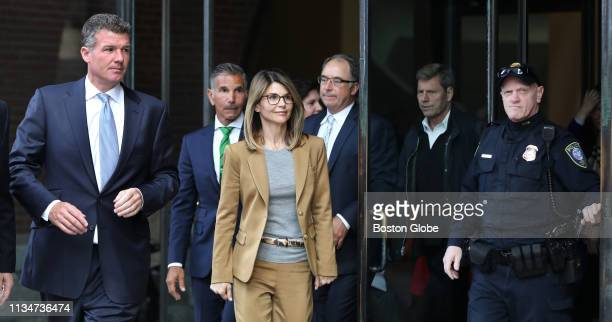 Actress Lori Loughlin center in tan and her husband Mossimo Giannulli in green tie behind her leave the John Joseph Moakley United States Courthouse...