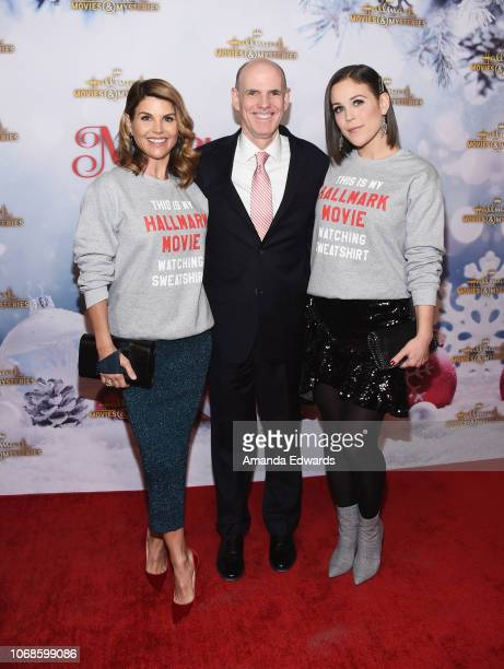 Actress Lori Loughlin Crown Media Family Networks President and CEO William J Abbott and actress Erin Krakow arrive at the Hallmark Channel Once Upon...