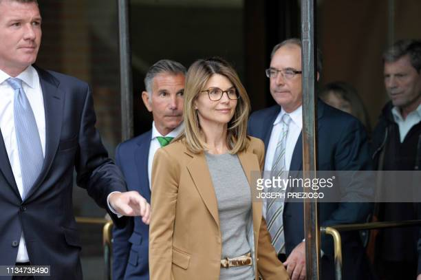 Actress Lori Loughlin exits the courthouse after facing charges for allegedly conspiring to commit mail fraud and other charges in the college...