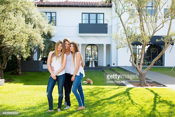 Actress Lori Loughlin is photographed with daughters Olivia and Isabella at home for People Magazine on May 19 2015 in Los Angeles California
