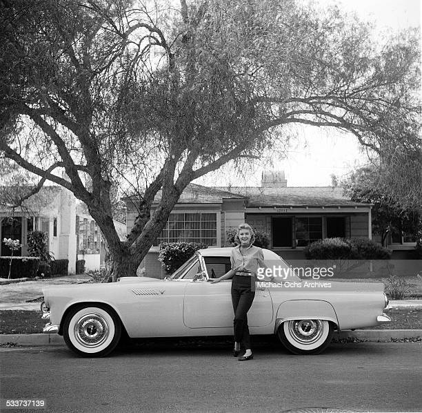 Actress Lori Nelson poses by her Ford Thunderbird car at home in Los AngelesCA
