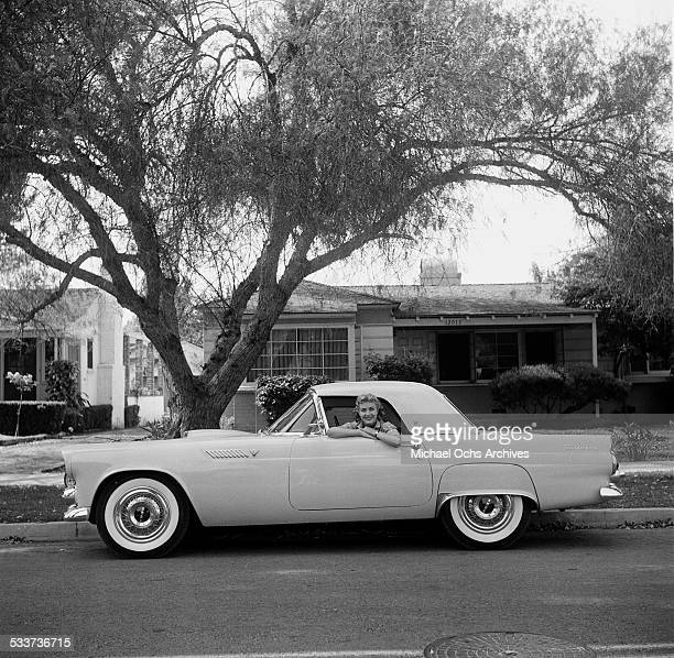 Actress Lori Nelson poses in her Ford Thunderbird car at home in Los AngelesCA