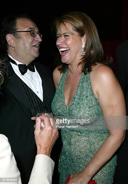 Actress Lorraine Bracco talks to Roger Friedman at the HBO post Emmy party following the 56th annual Primetime Emmy Awards held at the Pacific Design...