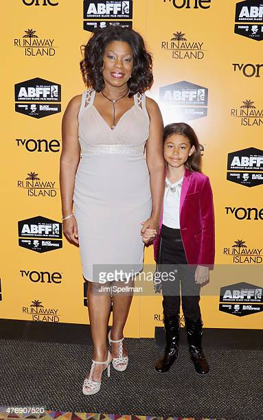 Actress Lorraine Toussaint and Samara attend the Runaway Island premiere during the 2015 American Black Film Festival at AMC Empire on June 12 2015...