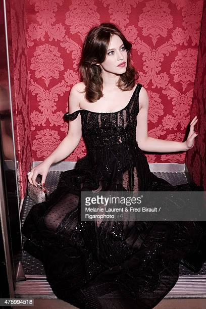 Actress Lou de Laage is photographed for Madame Figaro on April 30 2015 in Paris France Dress stockings ring clutch Makeup by Dior PUBLISHED IMAGE...