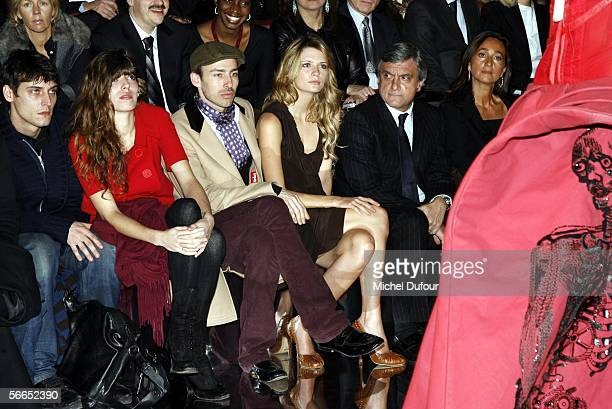 Actress Lou Doillon Alexis Roche and actress Mischa Barton attend the Christian Dior fashion show as part of Paris Fashion Week Spring/Summer 2006 on...