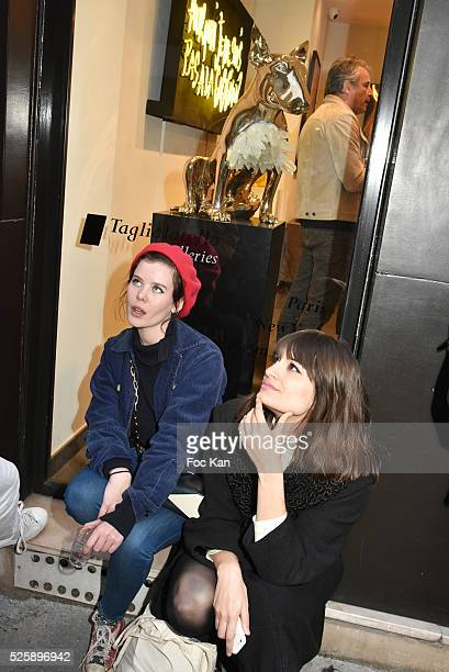 Actress Lou Lesage and singers Clara Luciani attend the 'As Hard' Pierre Emery Paintings /Collages Exhibition at Galerie Taglialatella Paris on April...