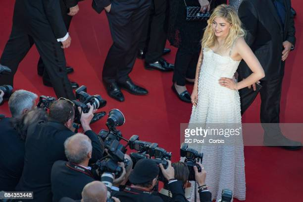 """Actress Louane Emera poses for the photographers before the """"Ismael's Ghosts """" screening and Opening Gala during the 70th annual Cannes Film Festival..."""