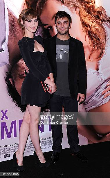 """Actress Louise Bourgoin and Actor Pio Marmai attend """"Un Heureux Evenement"""" premiere at UGC Cine Cite Bercy on September 26, 2011 in Paris, France."""