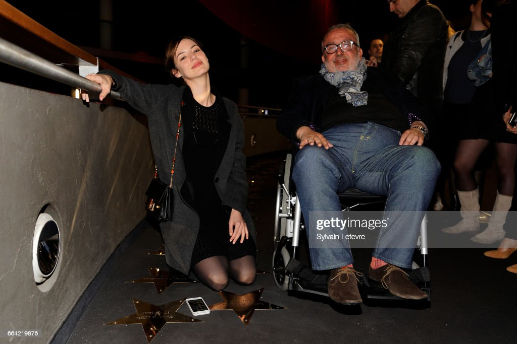 Actress Louise Bourgoin (L) and director Dominique Farrugia pose near the stars to their name before 'Sous Le Meme Toit' Premiere at Kinepolis on April 3, 2017 in Lille, France.