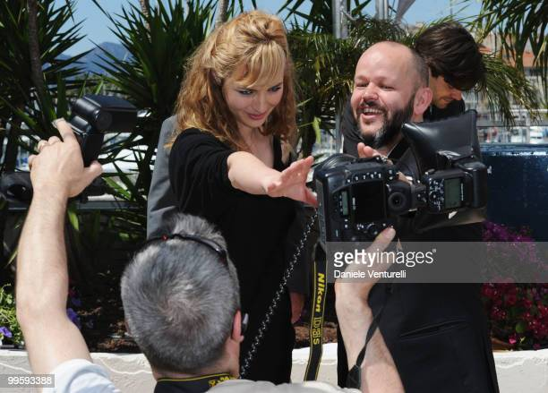 Actress Louise Bourgoin and Director Gilles Marchand pose for photographs as they attend the 'Black Heaven' Photo Call held at the Palais des...