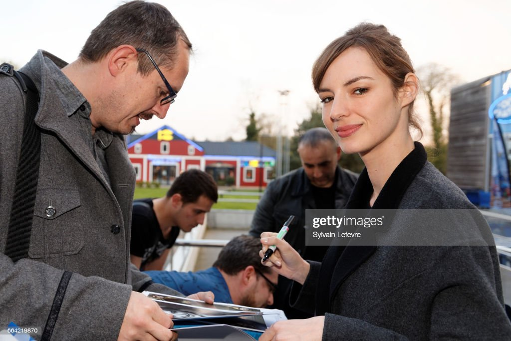 Actress Louise Bourgoin signs autographs before 'Sous Le Meme Toit' Premiere at Kinepolis on April 3, 2017 in Lille, France.