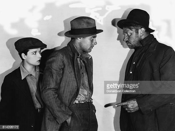 Actress Louise Brooks actors Richard Arlen and Wallace Beery in a scene from the movie Beggars of Life