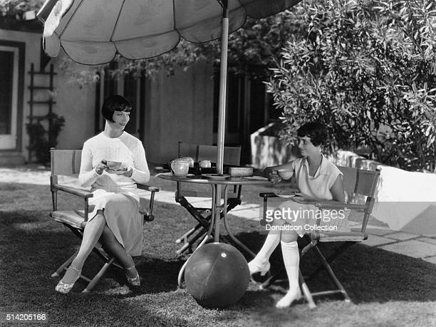 Actress Louise Brooks poses for a portrait session at home with her sister June Brooks in circa1925