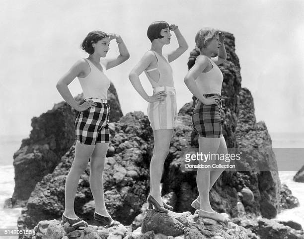 Actress Louise Brooks poses for a portrait session with 2 other women in circa1925