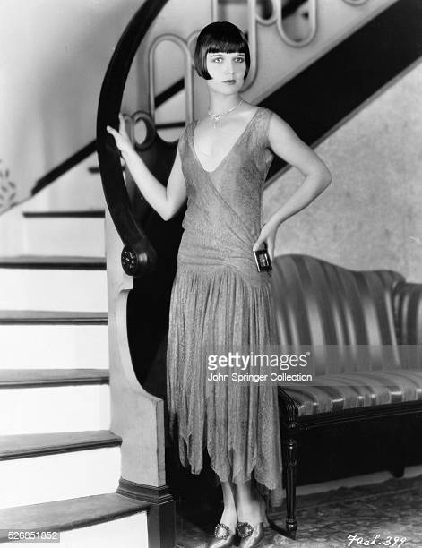Actress Louise Brooks Standing by Stairway