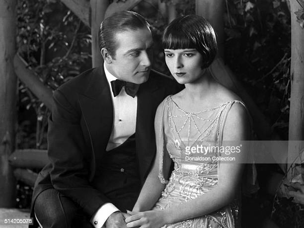Actress Louise Brooks with an actor in a scene from the movie Social Celebrity which was released in 1926