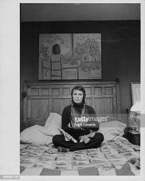 Actress Louise Lasser posing on the bed in her bedroom at her East Side Apartment New York City May 24th 1971