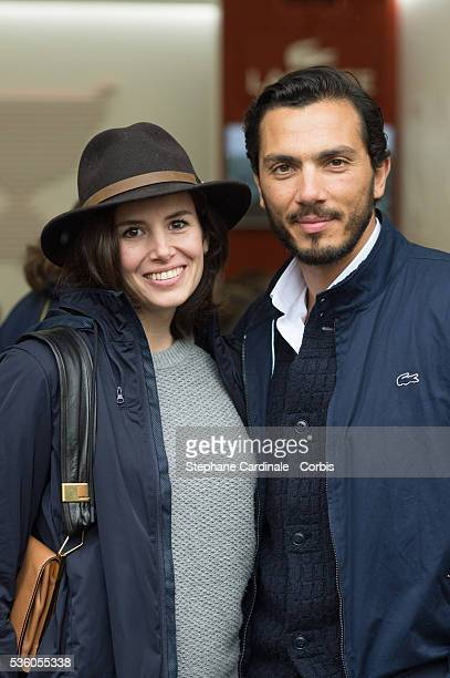 Actress Louise Monot and her companion actor Samir Boitar attend day ten of the 2016 French Open at Roland Garros on May 31 2016 in Paris France