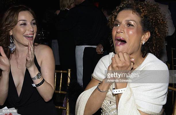 Actress Lucia Rijker cheers as costar Hilary Swank is named Best Actress at The Abbey/Esquire Magazine 'The Envelope Please' Oscar Viewing Party on...