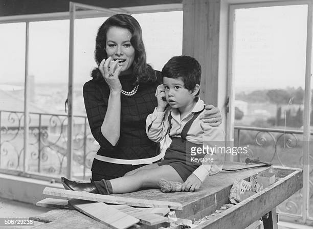 Actress Luciana Paluzzi and her young son Christian pictured in their new home during its renovation, on the Via Aurelia Antica in Rome, October 15th...